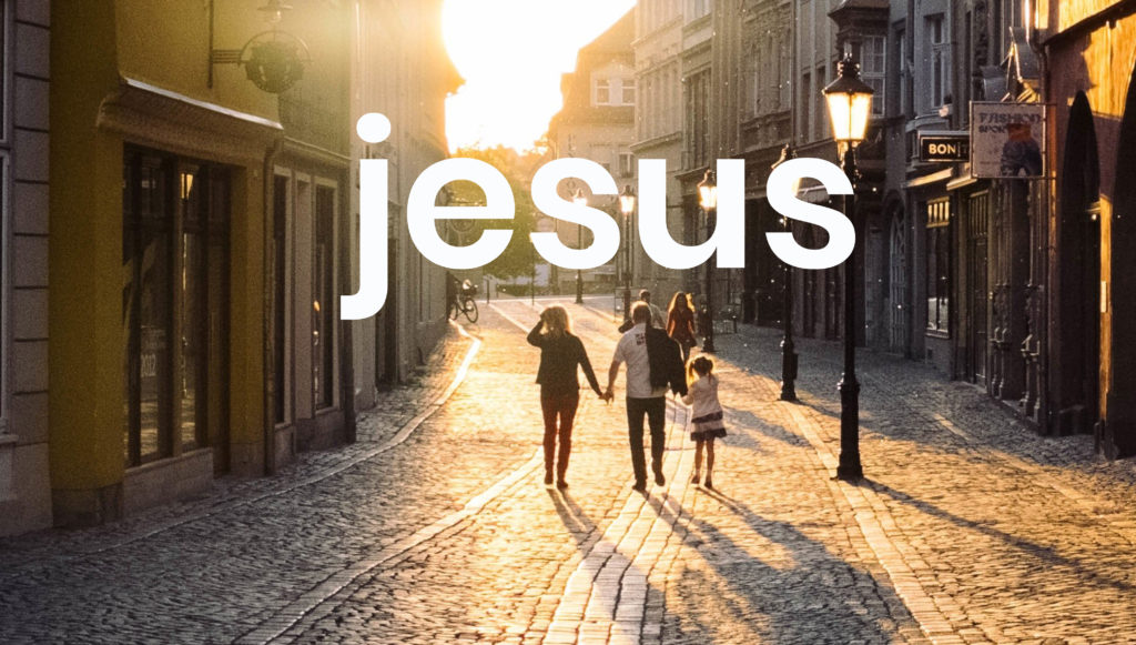 A family in the street with Jesus typed on image. Under Vision and mission