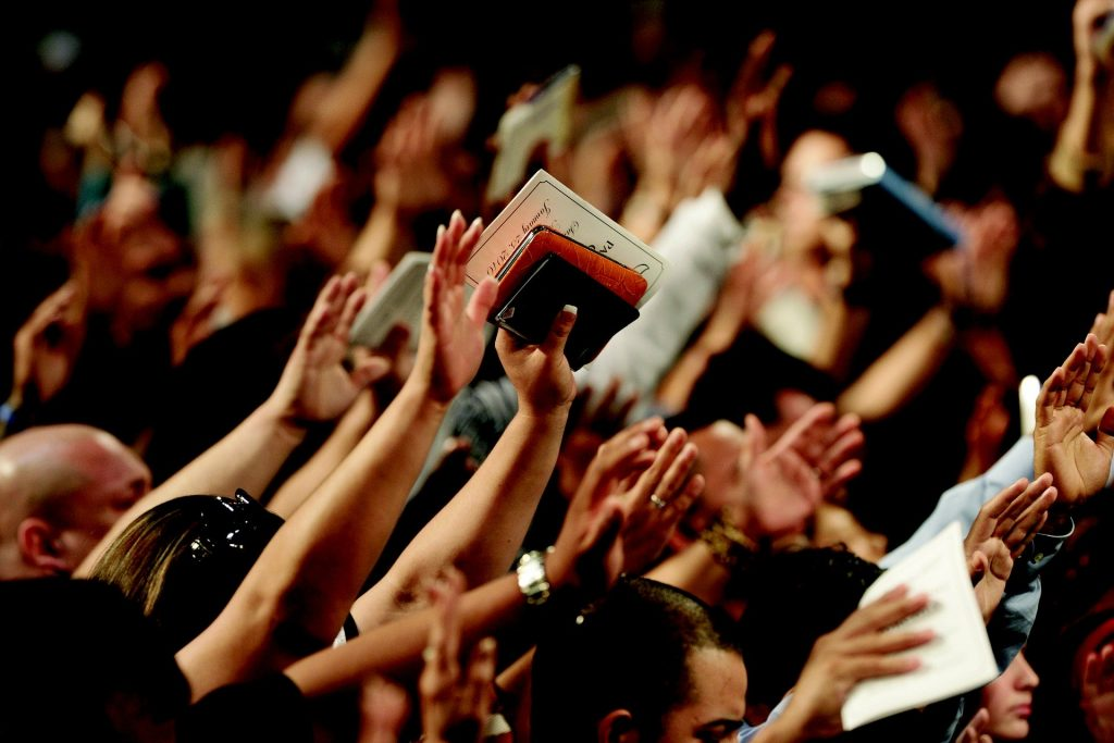 Photo ofHands raised in worship to God