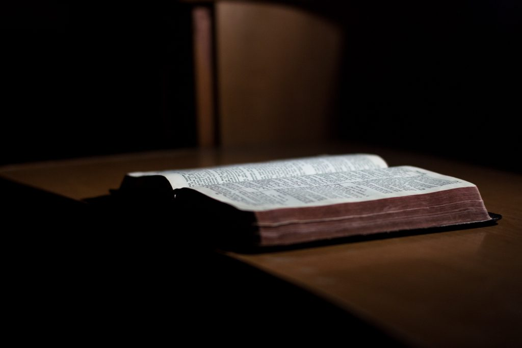 Bible open on desk. The Basis of Faith is based on biblical teaching